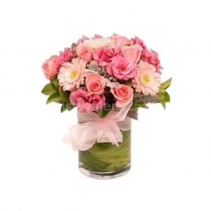 Jarrón de rosas rosa